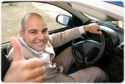 Man in car smiling because he finished his 8-hour traffic school course