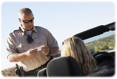 Florida police officer writing speeding ticket to female driver