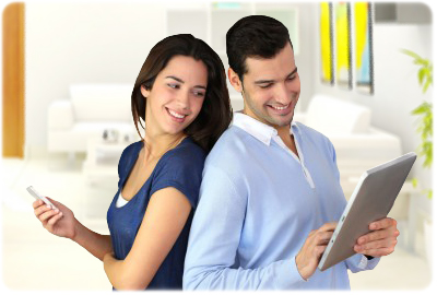 Image of woman holding iPhone and man holding iPad